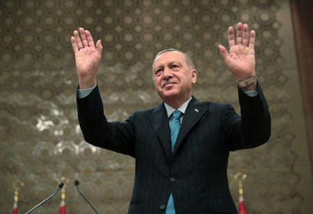 Turkish President Tayyip Erdogan greets the audience during a meeting in Ankara, Turkey, April 30, 2019. Murat Murat Cetinmuhurdar/Presidential Press Office/Handout via REUTERS