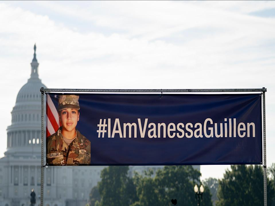 A banner with the image of slain Army Secialist Vanessa Guillen and #IAmVanessaGuillen is displayed before the start of a news conference on the National Mall in Washington, DC on 30 July ((Associated Press))