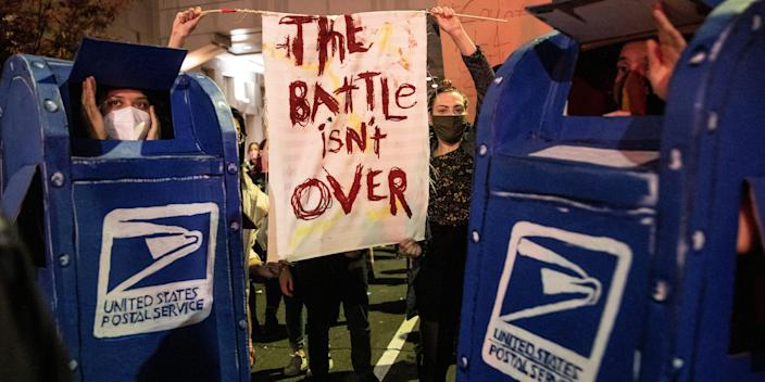 Protesters dressed as post office boxes.