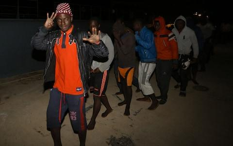 Migrants arrive at a naval base in Tripoli late on January 31, 2018, after they were rescued off Libya's coast. - Credit: AFP