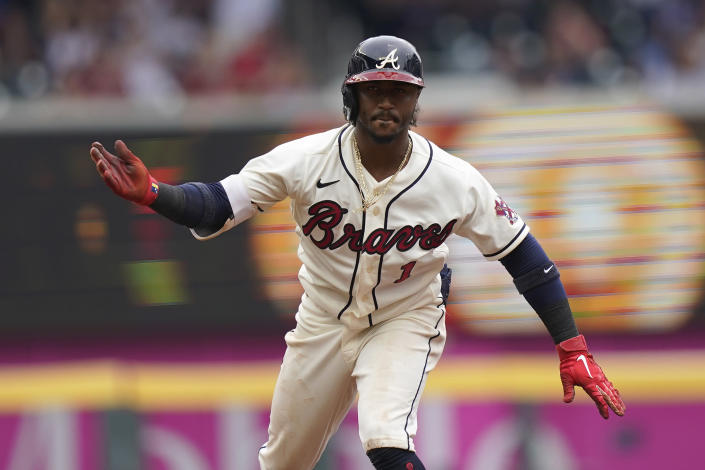 Atlanta Braves second baseman Ozzie Albies (1) reacts after hitting an RBI double in the third inning of a baseball game against the Los Angeles Dodgers Sunday, June 6, 2021, in Atlanta. (AP Photo/Brynn Anderson)