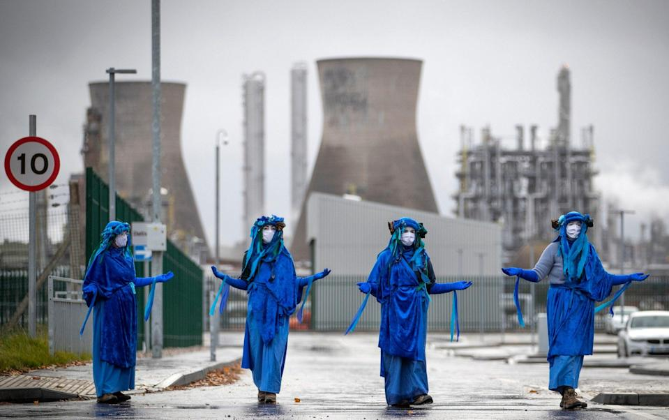 Extinction Rebellion Scotland blockade the road and demonstrate outside the Ineos oil refinery at Grangemouth - Jane Barlow/PA