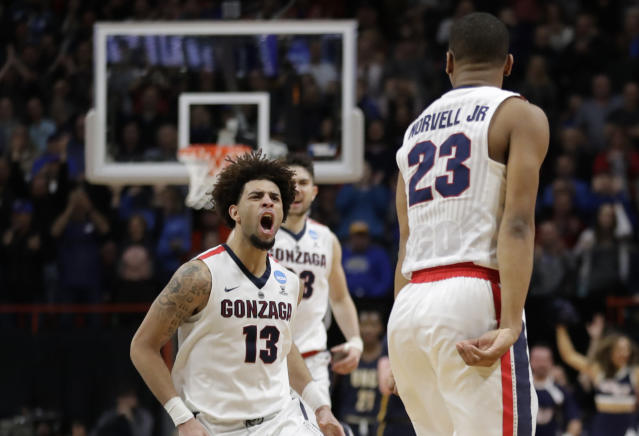 Gonzaga guard Josh Perkins (13) celebrates with guard Zach Norvell Jr. (23) after Norvell Jr. made a three-point shot in the final minute of the second half of an NCAA college basketball tournament first-round game against UNC-Greensboro, Thursday, March 15, 2018, in Boise, Idaho. Gonzaga won 68-64. (AP Photo/Ted S. Warren)