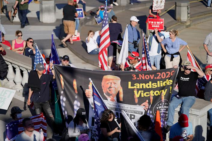 Supporters of President Donald Trump demonstrate near the Pennsylvania State Capitol, Saturday, Nov. 7, 2020, in Harrisburg, Pa., after Democrat Joe Biden defeated Trump to become 46th president of the United States.