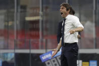 Inter Milan's head coach Antonio Conte gestures during a Serie A soccer match between Inter Milan and Torino, at the San Siro stadium in Milan, Italy, Monday, July 13, 2020. (AP Photo/Luca Bruno