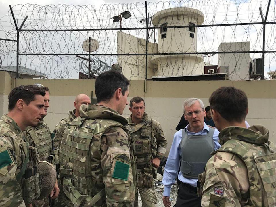 British ambassador to Afghanistan Sir Laurie Bristow, second right, also remains on the ground at Kabul airport to help organise the evacuations (FCO/PA) (PA Media)