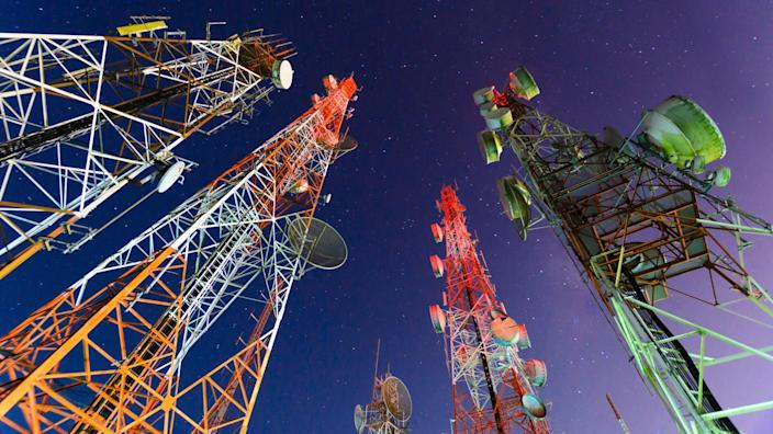Telecommunication mast with microwave link and TV transmitter antennas in night sky .