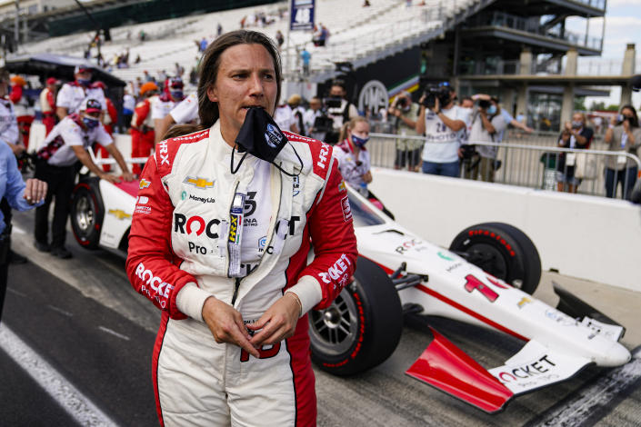 Simona De Silvestro, of Switzerland, stand next to her car after failing to break into a guaranteed spot in the race during qualifications for the Indianapolis 500 auto race at Indianapolis Motor Speedway in Indianapolis, Saturday, May 22, 2021. (AP Photo/Michael Conroy)