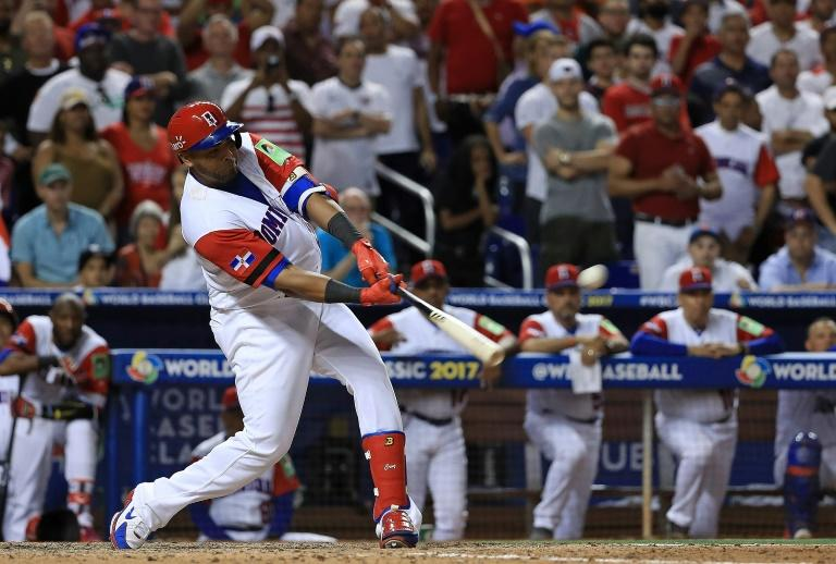 Nelson Cruz of the Dominican Republic hits a three run home run during the eighth inning against the United States in the World Baseball Classic