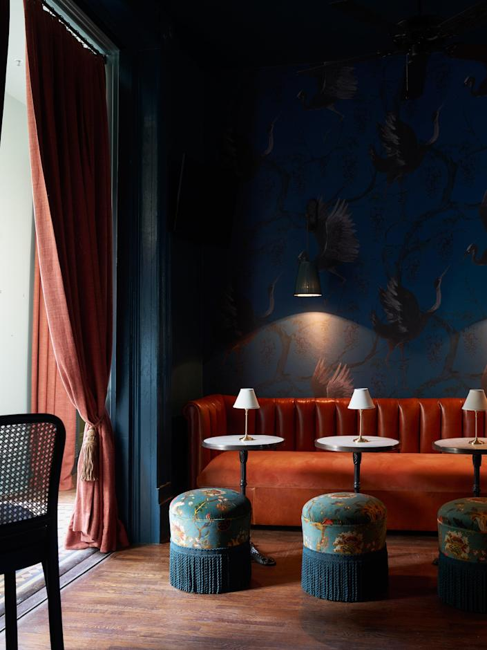"""<p><strong>Why book?</strong> The Chloe is the kind of place you stay when you want to experience <a href=""""https://www.cntraveler.com/destinations/new-orleans?mbid=synd_yahoo_rss"""" rel=""""nofollow noopener"""" target=""""_blank"""" data-ylk=""""slk:New Orleans"""" class=""""link rapid-noclick-resp"""">New Orleans</a> beyond the revelry of the French Quarter. Housed in a Thomas-Sully designed Victorian on the deliciously decadent real estate corridor of St. Charles Avenue, The Chloe has everything a genuine boutique should have—smart, beautifully appointed rooms; good food; excellent cocktails; thoughtful amenities; intimate service; and an oasis of a pool to boot.</p> <p><strong>Set the scene:</strong> This is <a href=""""https://www.cntraveler.com/story/new-orleans-uptown-neighborhood-is-having-a-renaissance?mbid=synd_yahoo_rss"""" rel=""""nofollow noopener"""" target=""""_blank"""" data-ylk=""""slk:Uptown New Orleans"""" class=""""link rapid-noclick-resp"""">Uptown New Orleans</a>, which means it can feel quite local and chi-chi, especially in a time when tourism is rather quiet. In this way, The Chloe has become a sort of living room for New Orleanians seeking an all-day al fresco retreat that isn't their own porch or backyard. The front yard and art-filled parlors are see-and-be-seen, while the backyard and pool are a little more hidden with a separate bar that cranks out frozen margaritas and beer-and-shot combos. For the most part, the crowd is very Uptown, which means a cross between Billy Reid- and Lilly Pulitzer-wearing 30- and 40-somethings, occasionally overlapping with a younger downtown vibe when live music pops up on the weekends. Regardless of your social alliances, there's always plenty of people-watching to do and local goings-on to be overheard after everybody's had a round or two of cocktails.</p> <p><strong>The backstory:</strong> Like all century-old properties in this city, The Chloe has lived many former lives. It was designed by 19th-century architect Thomas Sully for merchant Henry Picard and h"""