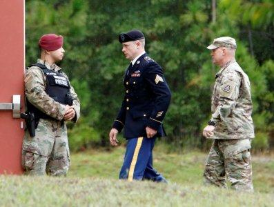 FILE PHOTO: Sgt. Robert B. Bergdahl (C) is escorted into the court house after a lunch break during his hearing in the case of United States vs. Bergdahl in Fort Bragg, North Carolina, U.S., October 16, 2017. REUTERS/Jonathan Drake/File Photo