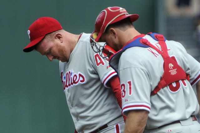Philadelphia Phillies pitcher Zach Miner, left, is visited at the mound by catcher Erik Kratz (31) during the first inning of a baseball game against the Atlanta Braves, Sunday, Sept. 29, 2013, in Atlanta. (AP Photo/John Amis)