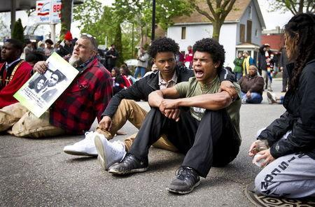 Jordan King, right, chants while blocking traffic along Williamson Street after a prosecutor said that a police officer will not face charges in the fatal shooting of an unarmed 19-year-old biracial man, in Madison, Wisconsin May 12, 2015. REUTERS/Ben Brewer