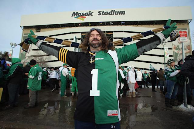 REGINA, SK - NOVEMBER 24: Chuck Denisthk celebrates prior to the start of the 101st Grey Cup Championship Game against the Hamilton Tiger-Cats and the Saskatchewan Roughriders at Mosaic Stadium on November 24, 2013 in Regina, Canada. (Photo by Jeff Gross/Getty Images)