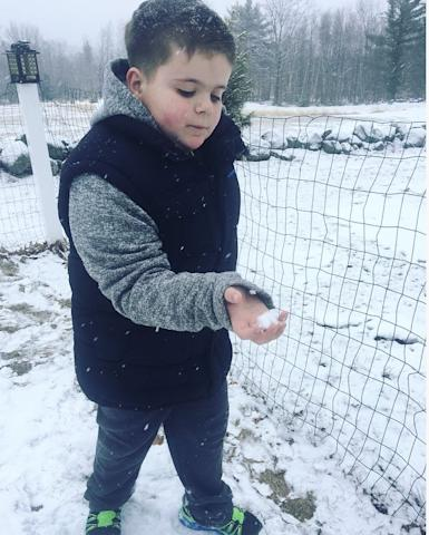 Young boy holding a snow ball