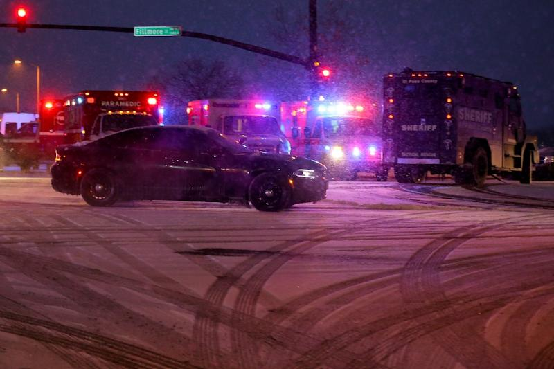 A police vehicle carrying a suspect drives away from the scene during an active shooter situation outside a Planned Parenthood facility on November 27, 2015 in Colorado Springs, Colorado (AFP Photo/Justin Edmonds)