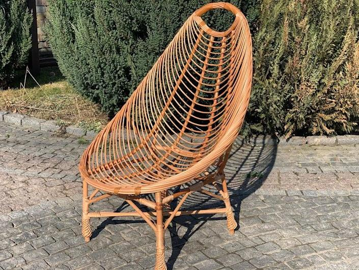 """Now don't you want to lounge outside all day in this? Made of environmentally friendly vines, this wicker chair is ideal for basking in the sun. $85, Etsy. <a href=""""https://www.etsy.com/listing/973892101/patio-furniture-rattan-furniture-wicker?ga_order=most_relevant&ga_search_type=all&ga_view_type=gallery&ga_search_query=patio+furniture&ref=sr_gallery-1-5&organic_search_click=1&pro=1"""" rel=""""nofollow noopener"""" target=""""_blank"""" data-ylk=""""slk:Get it now!"""" class=""""link rapid-noclick-resp"""">Get it now!</a>"""