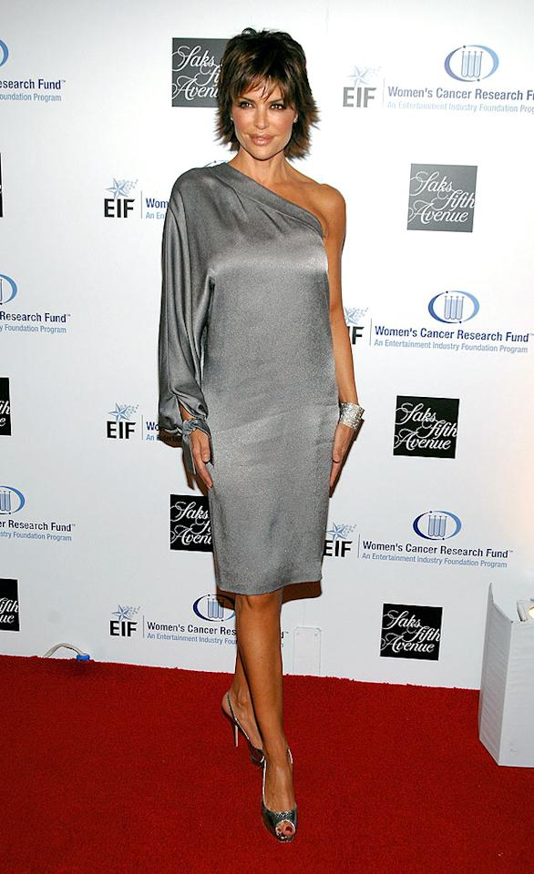"""Lisa Rinna's gray getup accentuates her overly-bronzed bod. John Shearer/<a href=""""http://www.wireimage.com"""" target=""""new"""">WireImage.com</a> - February 10, 2009"""