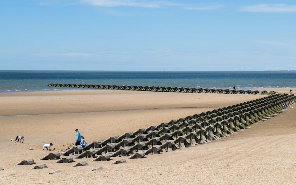 Modern sea defences at Wallasey beach today - Getty