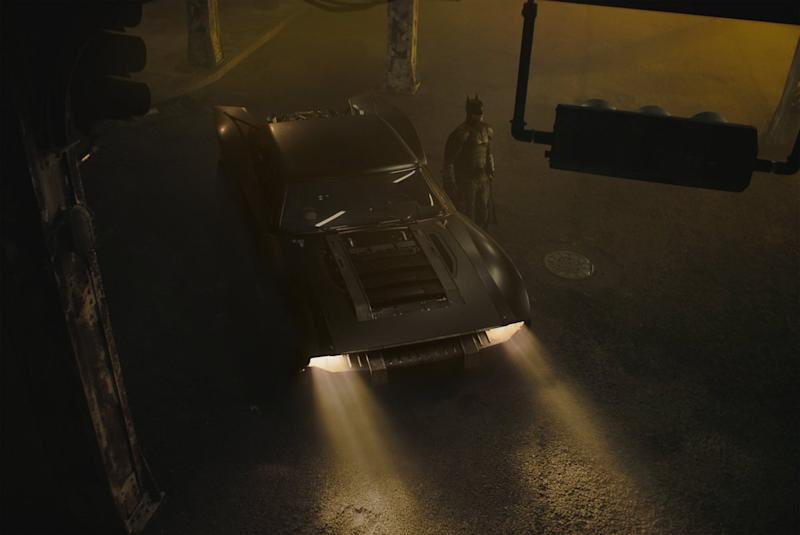 Robert Pattinson as the new Batman standing next to the new Batmobile in 'The Batman' (Photo: Matt Reeves/Twitter)