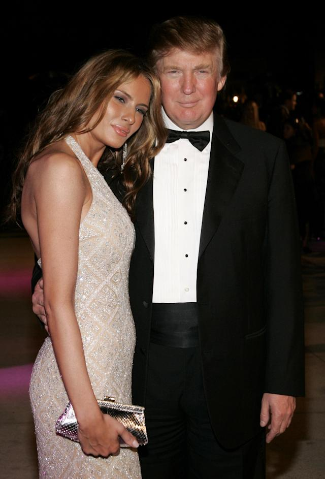 "<p>The newly married Trumps look smitten, with Melania resting her head on Donald's shoulder. The couple's ""I do's"" were just a month prior, on Jan. 22, 2005. (Photo: Getty Images) </p>"
