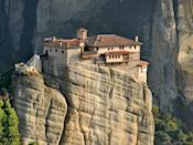 As if still-standing monasteries from the 15th century weren't impressive enough, the buildings of Meteora are famously situated on nearly inaccessible sandstone peaks in central Greece. Brave travelers can pay a visit to the Monastery of the Holy Trinity—one of six monasteries that are still standing—via a 140-step staircase cut into the side of the cliff.