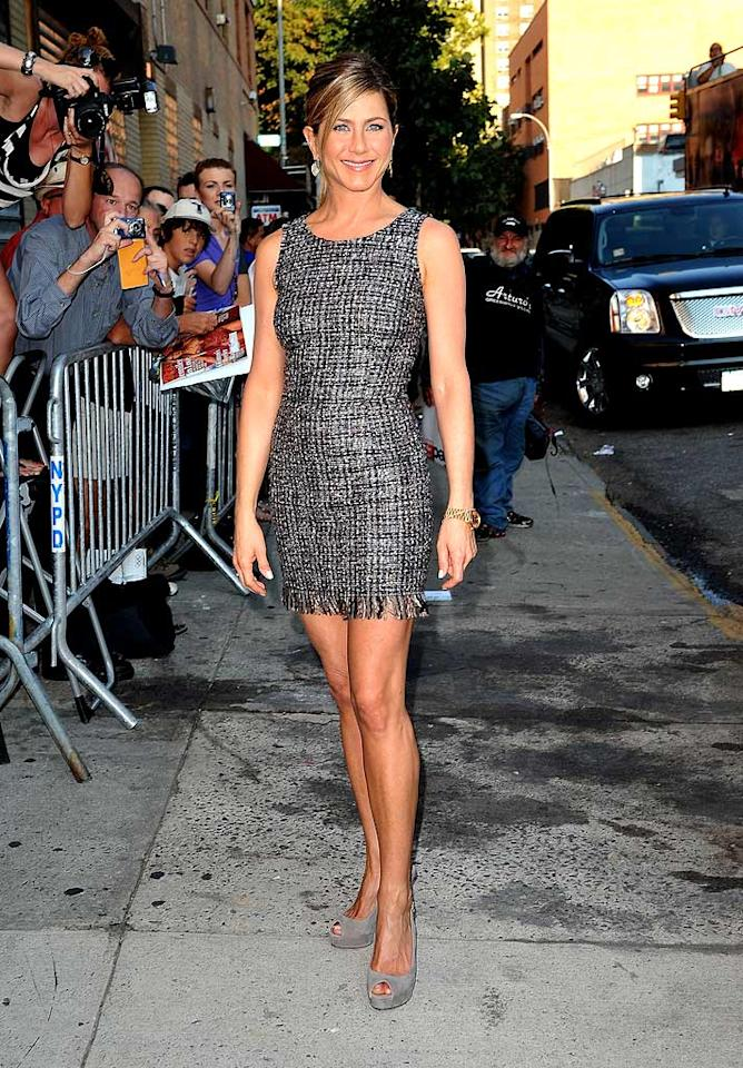 "Her latest film, ""The Switch,"" only earned a measly $8 million at the box office this past weekend, but at least its star, Jennifer Aniston, looked like a million bucks upon arriving at ""The Daily Show"" to promote the project in a beaded Dolce & Gabbana mini and matching Gucci peep-toes. James Devaney/<a href=""http://www.wireimage.com"" target=""new"">WireImage.com</a> - August 19, 2010"