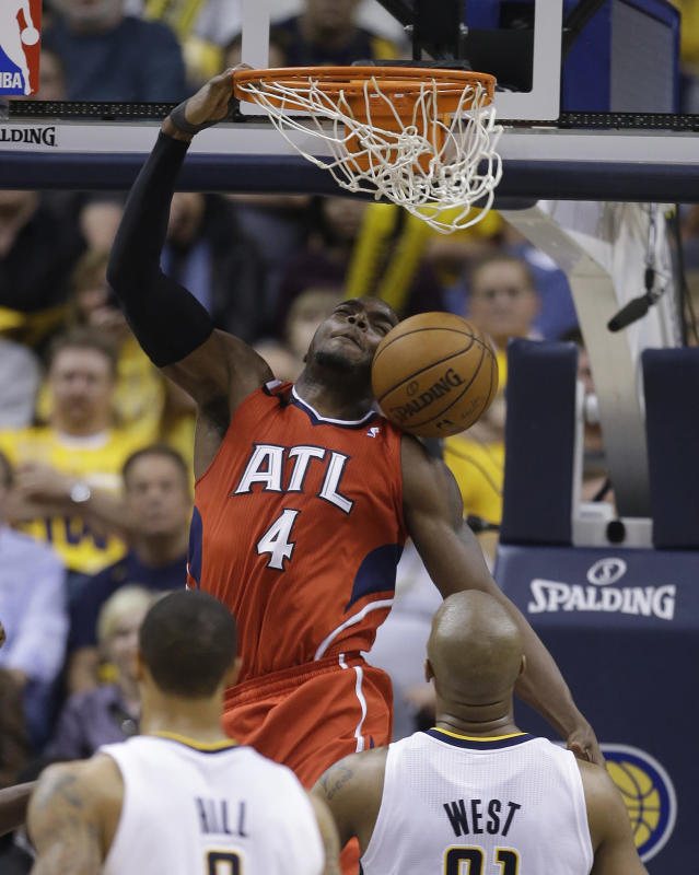 Atlanta Hawks' Paul Millsap (4) dunks as Indiana Pacers' David West (21) watches during the second half in Game 5 of an opening-round NBA basketball playoff series Monday, April 28, 2014, in Indianapolis. Atlanta defeated Indiana 107-97. (AP Photo/Darron Cummings)