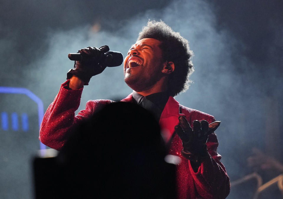 FILE - The Weeknd performs during the halftime show of the NFL Super Bowl 55 football game on Feb. 7, 2021, in Tampa, Fla. The Weeknd was snubbed by the Grammys but he's the leading nominee at the 2021 Billboard Music Awards. (AP Photo/David J. Phillip, File)