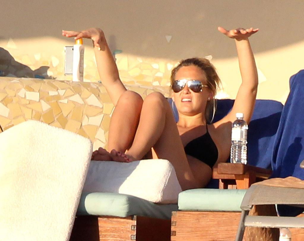 """Israeli model Bar Refaeli flaunted her curves poolside in Cabo minus her longtime boyfriend Leonardo DiCaprio, who reportedly spent the holidays in L.A. Do you think there's trouble in paradise? Clasos.com/<a href=""""http://www.splashnewsonline.com"""" target=""""new"""">Splash News</a> - December 28, 2010"""