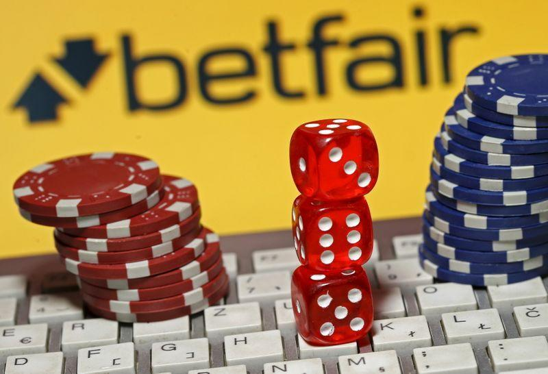 Betfair logo is seen behind a keyboard, gambling dice and chips in this illustration taken in Sarajevo