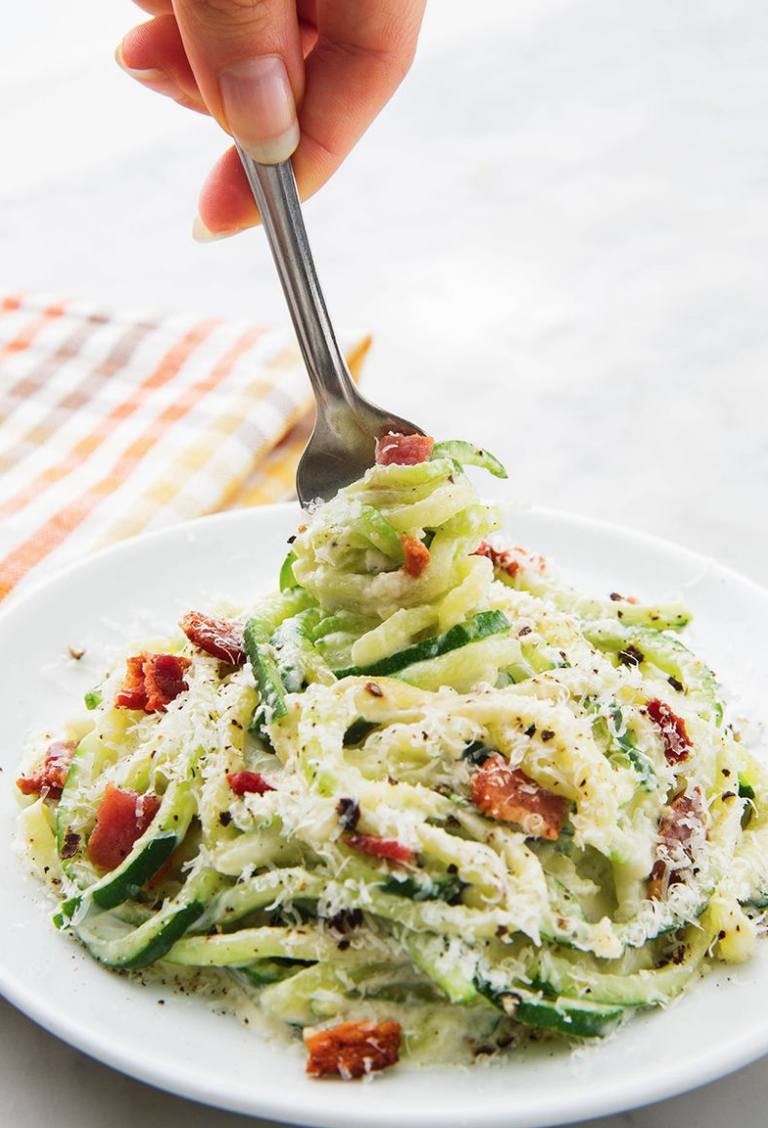 """<p>Just as creamy and cheesy as the original, you'll love how the crispy bits of bacon cut through soft noodles in this Alfredo. </p><p><em><a href=""""https://www.delish.com/cooking/recipe-ideas/a24742964/keto-zoodles-alfredo-sauce-recipe/"""" rel=""""nofollow noopener"""" target=""""_blank"""" data-ylk=""""slk:Get the recipe from Delish »"""" class=""""link rapid-noclick-resp"""">Get the recipe from Delish »</a></em></p>"""