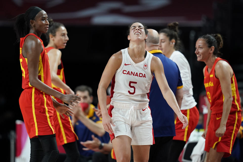 Canada's Kia Nurse (5), center, reacts after losing the ball during women's basketball preliminary round game against Spain at the 2020 Summer Olympics, Sunday, Aug. 1, 2021, in Saitama, Japan. (AP Photo/Charlie Neibergall)