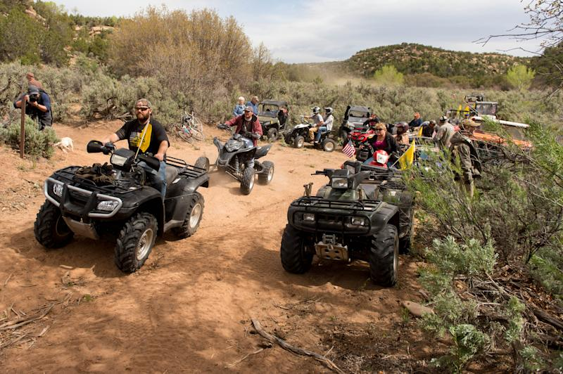 ATV riders cross into a restricted area of Recapture Canyon, north of Blanding, Utah, on Saturday, May 10, 2014, in a protest against what demonstrators call the federal government's overreaching control of public lands. The area has been closed to motorized use since 2007 when an illegal trail was found that cuts through Ancestral Puebloan ruins. The canyon is open to hikers and horseback riders. (AP Photo/The Salt Lake Tribune, Trent Nelson)
