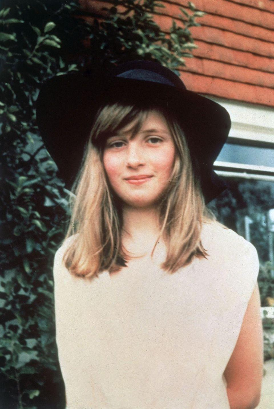 <p>Before she graduated to elaborate fascinators, Di went with a classic black chapeau in her formative years.</p>