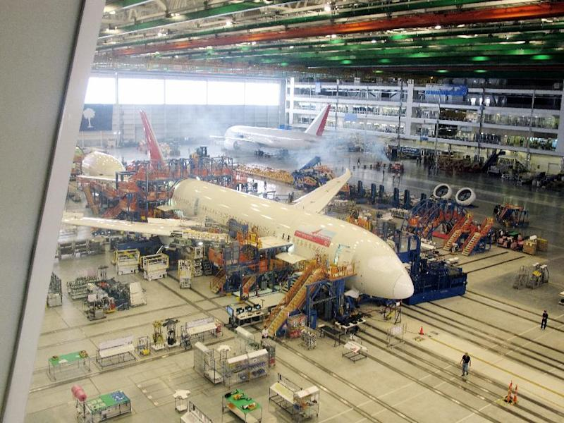 FILE - In this April 27, 2012 photo, workers at Boeing's assembly plant in North Charleston, S.C. assemble a 787 jetliner. The company said Thursday that production continues normally at the plant despite the FAA grounding 787s now in service to check the safety of on board batteries.  (AP Photo/Bruce Smith, file)