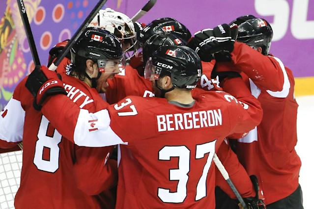 Team Canada celebrates their 1-0 victory over the USA in the men's semifinal ice hockey game at the 2014 Winter Olympics, Friday, Feb. 21, 2014, in Sochi, Russia. (AP Photo/Matt Slocum)