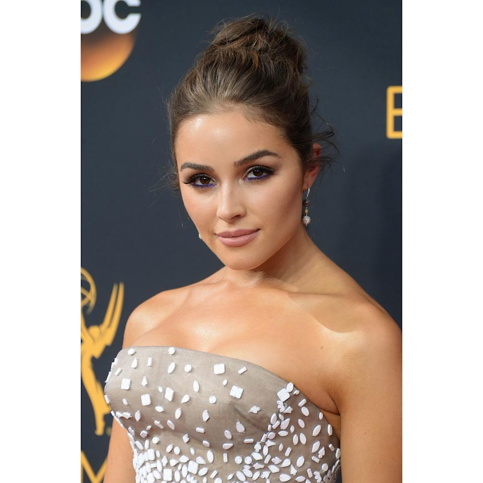 <p>Never underestimate the power of a skilled tightline. For the Emmys, Olivia Culpo rimmed her bottom waterline with a fiery sapphire, then lit up the top lashline with a rim of gold. The combination felt both rich and riotous.</p>