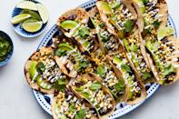 """Ripe summer corn is so delicious, so fresh, and so full of flavor, you can enjoy it raw. Filled with black beans, avocado, and raw corn marinated in bright lime juice along with jalapeño, cilantro, and toasted nuts and seeds, these hearty tacos make an easy to cook, easy to eat weeknight dinner. <a href=""""https://www.epicurious.com/recipes/food/views/spicy-black-bean-and-corn-tacos?mbid=synd_yahoo_rss"""" rel=""""nofollow noopener"""" target=""""_blank"""" data-ylk=""""slk:See recipe."""" class=""""link rapid-noclick-resp"""">See recipe.</a>"""