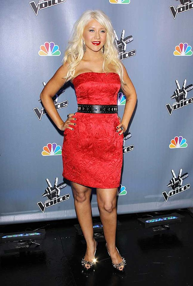 """Fellow diva Christina Aguilera -- who's had her fair share of problems over the past few months -- pulled it together (and looked quite nice) at a press conference for her new reality show, """"The Voice,"""" in a slimming cocktail frock, studded belt, and spiked Christian Louboutin heels. Michael Tran/<a href=""""http://www.filmmagic.com/"""" target=""""new"""">FilmMagic.com</a> - March 15, 2011"""
