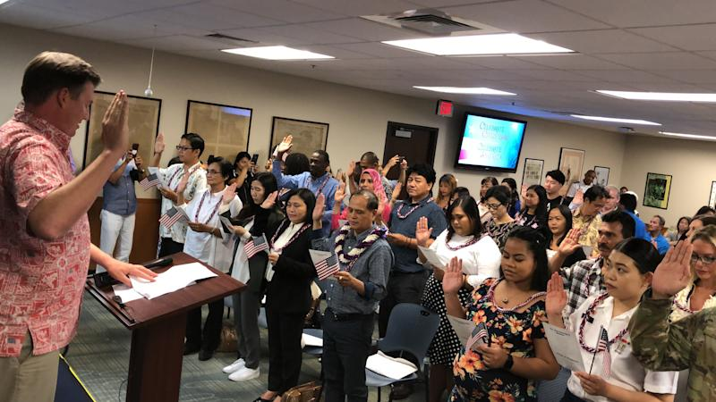Led by a United States Citizenship and Immigration Services (USCIS) official, 44 newly minted US citizens from 16 countries recite the Pledge of Allegiance in Honolulu, Hawaii on 24 April 2019. PHOTO: Nicholas Yong/Yahoo News Singapore