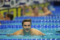Bobby Finke reacts after winning the men's 1500 freestyle during wave 2 of the U.S. Olympic Swim Trials on Sunday, June 20, 2021, in Omaha, Neb. (AP Photo/Jeff Roberson)
