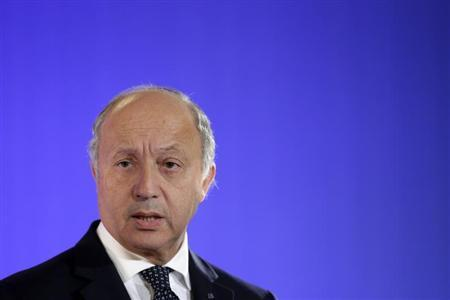 French Foreign Affairs Minister Fabius attends a news conference with US Secretary of State Kerry at the Quai d'Orsay Foreign Ministry after their meeting in Paris