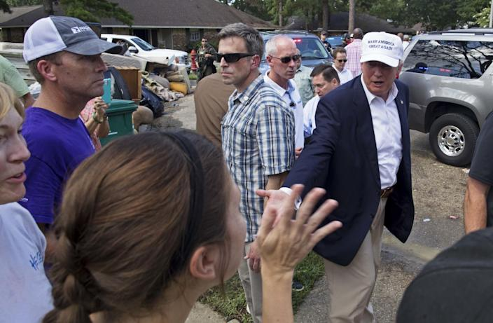 Republican presidential candidate Donald Trump greets flood victims during a tour of flood-damaged homes in Denham Springs, La., on Aug. 19. (Photo: Max Becherer/AP)