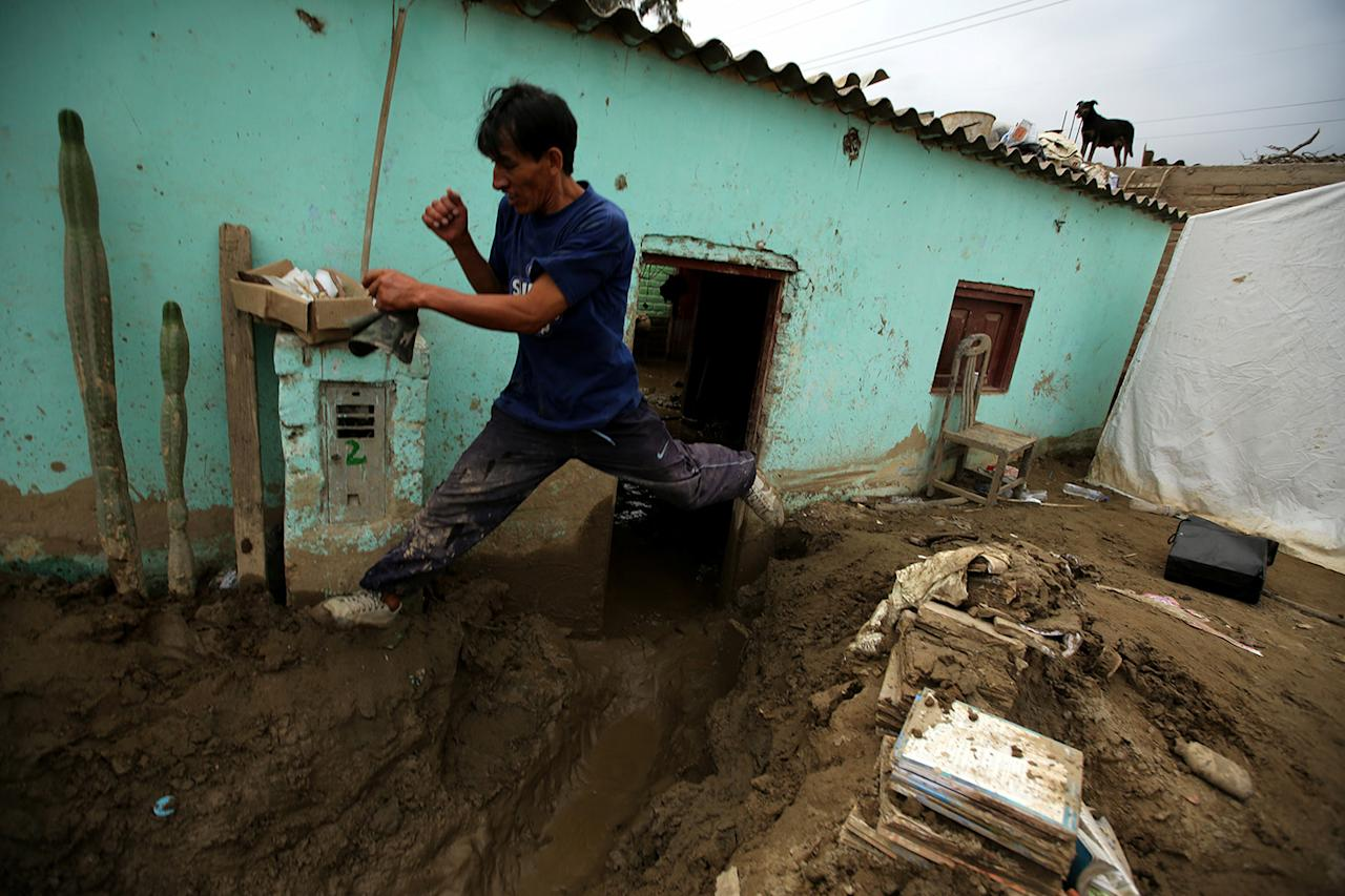 <p>A resident jumps next to his destroyed home after rivers breached their banks due to torrential rains, causing flooding and widespread destruction in Cajamarquilla, Lima, Peru, March 19, 2017. (Mariana Bazo/Reuters) </p>