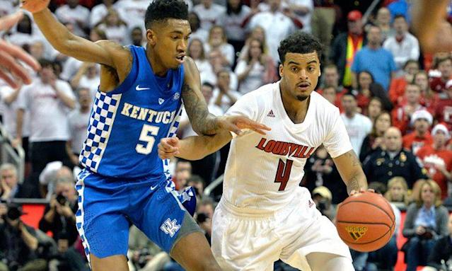 Louisville's Quentin Snider (4) attempts to drive past the defense of Kentucky's Malik Monk (5) during the second half on Wednesday. (AP)