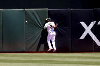 Oakland Athletics' Starling Marte can't catch a double hit by San Diego Padres' Trent Grisham during the fourth inning of a baseball game in Oakland, Calif., Wednesday, Aug. 4, 2021. (AP Photo/Jed Jacobsohn)
