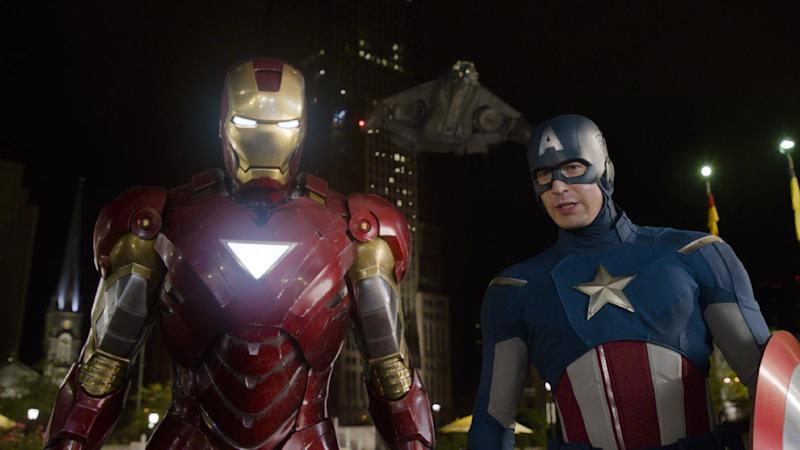 """In this film image released by Disney, Iron Man, portrayed by Robert Downey Jr., left, and Captain America, portrayed by Chris Evans, are shown in a scene from """"The Avengers"""" (AP Photo/Disney)"""