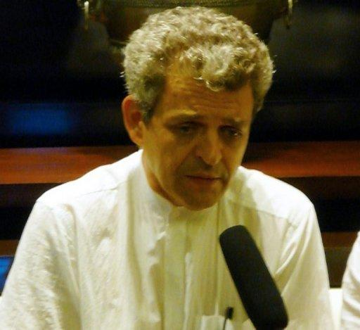 French architect Patrick Devillers speaks to reporters during an interview at Cambodia's Phnom Penh International Airport on July 17. Devillers, 52, is understood to have been a close business associate and friend of Bo and his wife Gu Kailai, key figures in China's biggest political scandal in decades, although his exact role is unclear