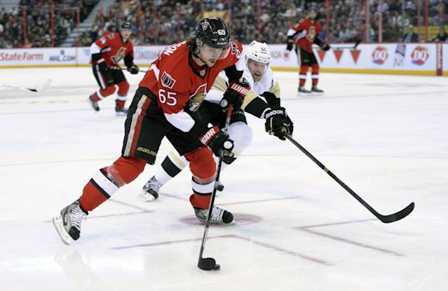 Ottawa Senators' Erik Karlsson, left, takes a shot on net as Pittsburgh Penguins' Philip Samuelsson attempts to defend during the second period of an NHL hockey game in Ottawa, Ontario on Monday, Dec. 23, 2013. (AP Photo/The Canadian Press, Sean Kilpatrick)
